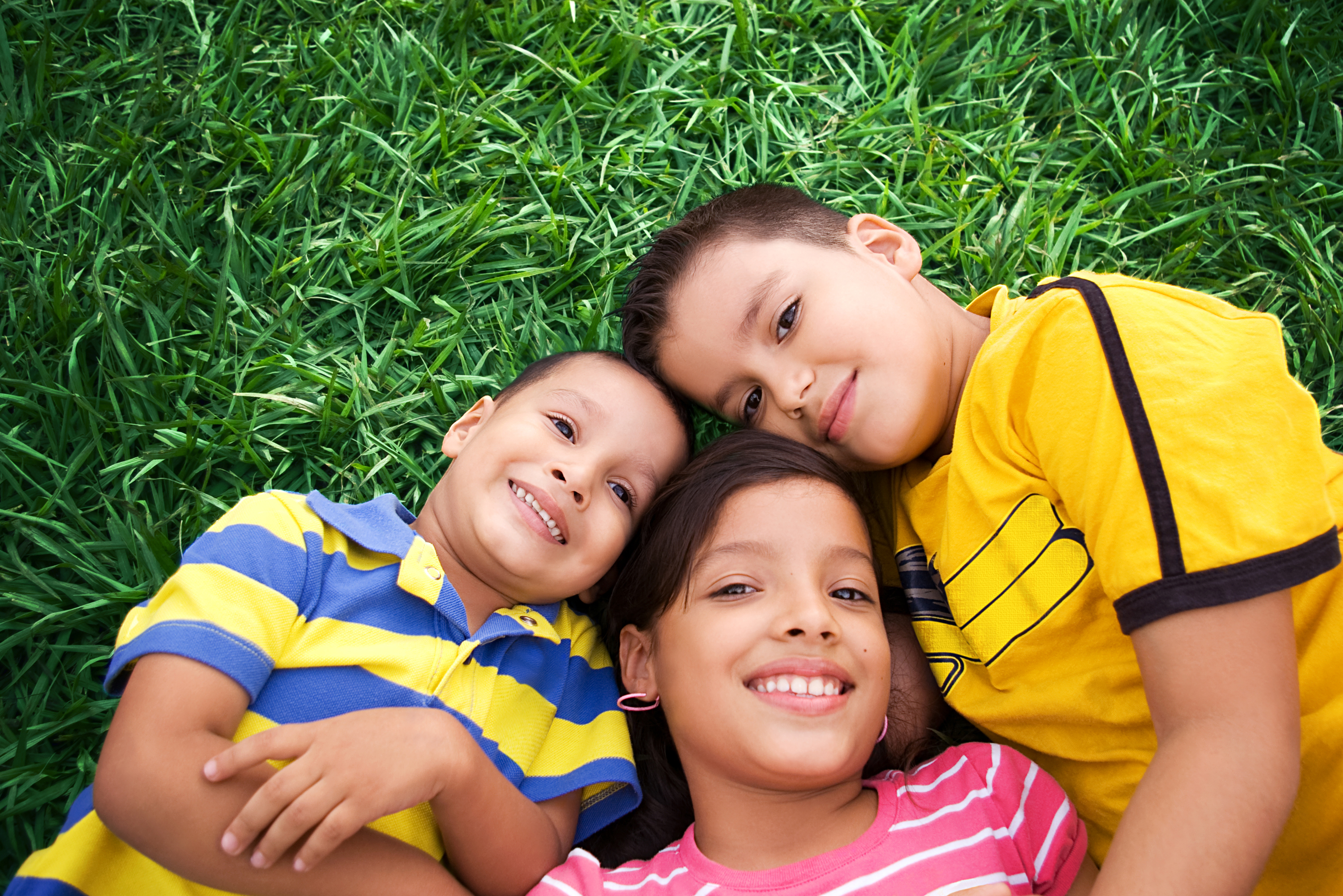 Children together in the grass